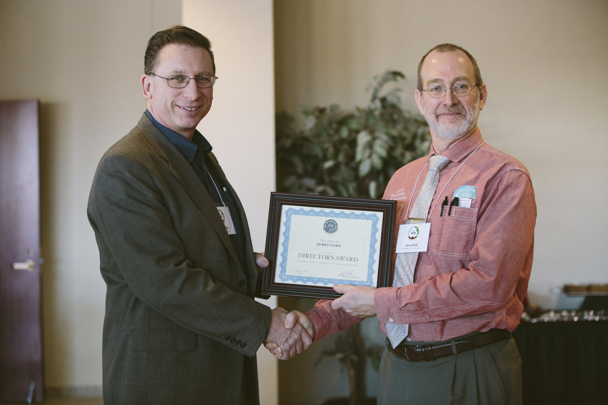SFA Executive Director John Mesko (left) gave the 2016 SFA Director's Award to SFA Network Coordinator Jerry Ford at the 2016 SFA Annual Conference on Feb. 13 in St. Joseph, Minn.