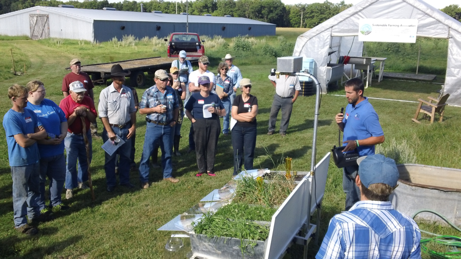 NRCS Grazing Specialist Tom Gervais demonstrates the rainfall simulator at SFA's GrazeFest event Aug. 10 at Wellspring Farms near Aitkin, Minn. The simulator demonstrates how soils with different management histories respond to a heavy rain.