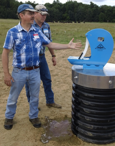 "Grazefest participants inspect the ""Frost-Free Nose Pump,"" developed in Alberta, Canada. The nose pump will facilitate cattle outwintering to help build soil fertility and serve as an emergency water source."