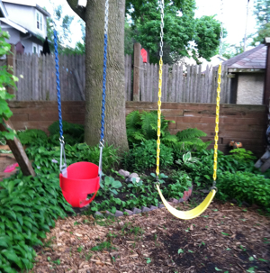 Jason and Leita's kids, Hank and Nettie, each have swings in the tiny yard. They try, but still manage to trample garden plants all the time.