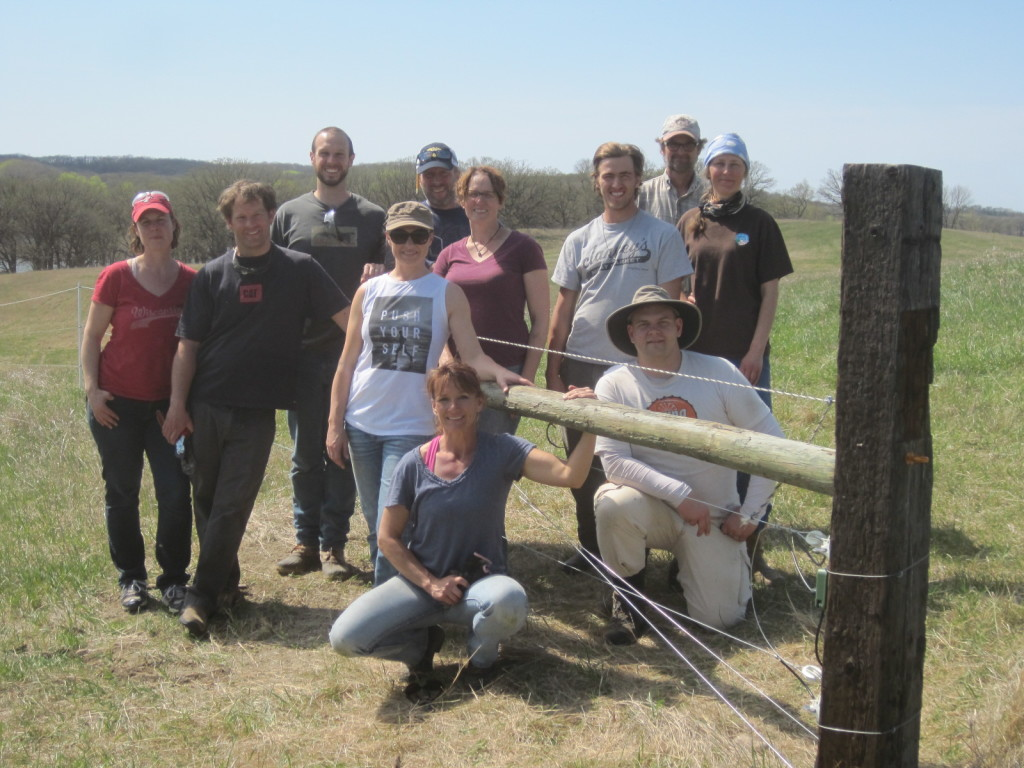 The Spring 2015 Farm Skills 101 Class. Pictured are, kneeling: Karla Chandler; Rick Cedergren. Second row: Tiffany Tripp, Andy Olson, Dacia Stiles. Behind the H-brace (standing): Seth Dutcher, instructor Kent Solberg, Julia Sandstrom, Eli Utne, and instructors Tom Prieve and Sue Wika.