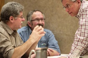 Organic Valley's Joe Borgerding (left) and Ken Larson (center) chat with Chris Barnier at the 2014 SFA Midwest Soil Health Summit.