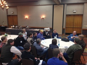 Midwest Soil Health Summit Keynote Speaker Gabe Brown at a discussion table, 2/18/15
