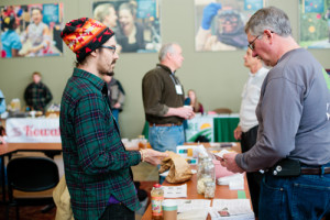 Zachary Paige (left) volunteers at the SFA Annual Conference Seed Swap. Here he is shown chatting with SFA member Dennis Ingle during the 2014 conference in St. Joseph, Minn.