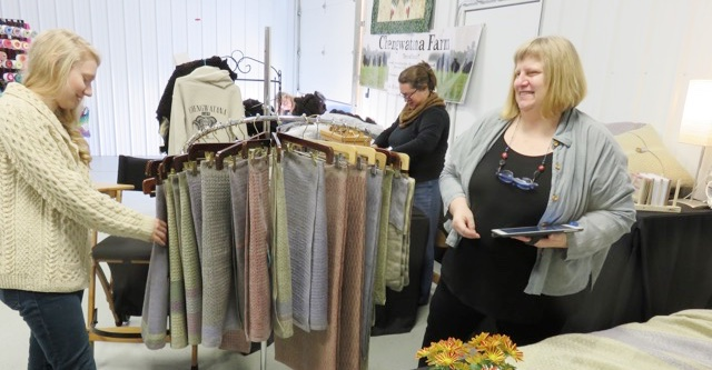 Sustainable fashion designer Keila McCracken visits with Marian Quanbeck Dahlberg during the 2015 Fosston Fiber Festival. Photo by Alethea Kenney.