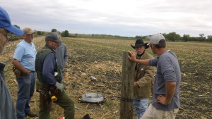 "Attendees discuss the finer points of corner posts during SFA's workshop, ""Fencing Innovations, Livestock & Cover Crops,"" held Sept. 18 in Marshall, Minn."