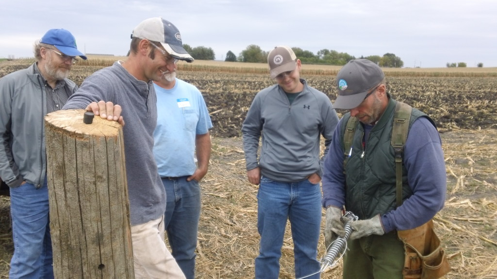 "Kent Solberg (right), SFA Livestock & Grazing Specialist, demonstrates installation of a tension spring and strainer during our recent workshop, ""Fencing Innovations, Livestock & Cover Crops,"" held Sept. 18, 2015, in Marshall, Minn."