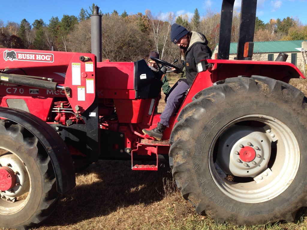 Cassi Dutcher learns to drive a tractor.