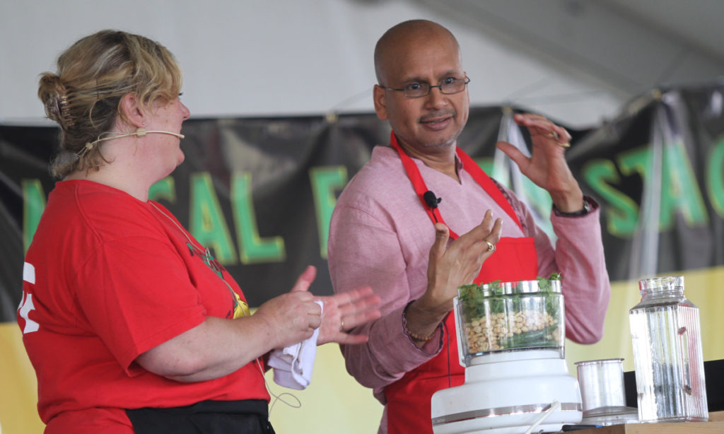 Mary Jane and Iyer cook stage garlic festival