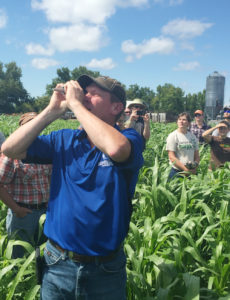 Grant Breitkreutz uses a refractometer during a 2016 SFA field day at his farm.